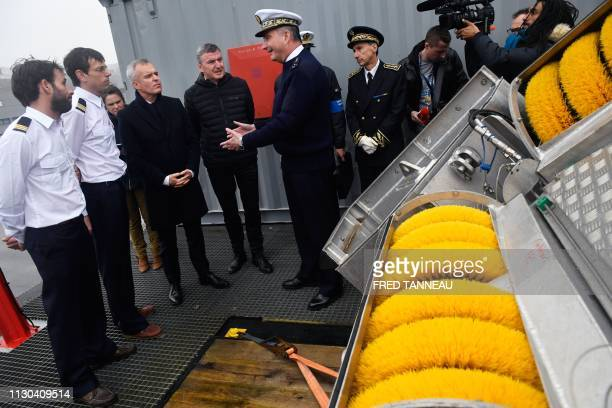 French Atlantic Maritime Prefect JeanLouis Lozier speaks as commander of the 'VN Partisan' ship Herve Bouche French Ecological and Inclusive...