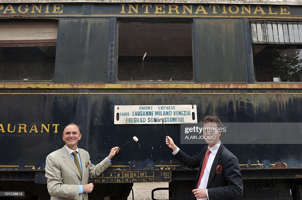 French auctioneers Philippe (L) and Aymeric Rouillac pose on May 27, 2010 at La Ferte-Saint-Aubin, central France, in front a sleeping-car built in 1949, which was once part of the famous Orient-Express train. The car will auctionned off with another one, a train dining-car built in 1928, on June 5 and 6. The Orient Express was the name of a long-distance passenger train originally operated by the Compagnie Internationale des Wagons-Lits between Paris and Istanbul. Although it was simply a normal international railway service, the name became synonymous with intrigue and luxury travel.