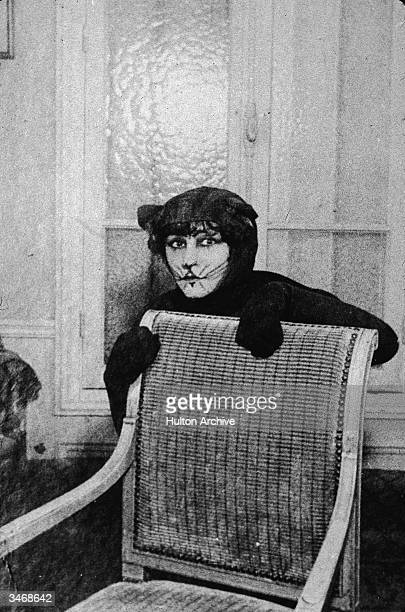 French author, actress, and singer Colette appears on stage in 'La Chatte Amoureuse,' a nightclub mine act in which she portrayed a cat, Paris,...