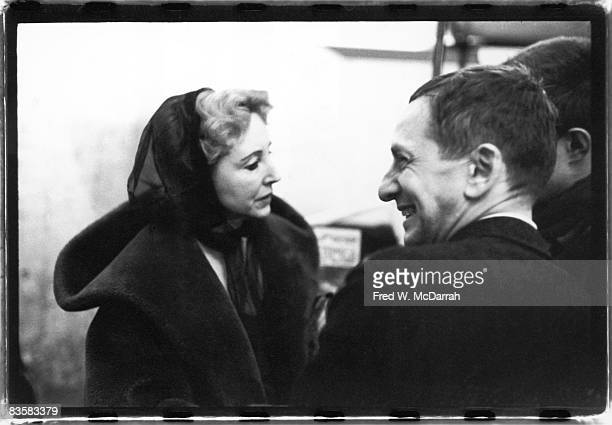 French author and diarist Anais Nin and American bookstore owner Ted Wilentz talk during intermission at the Living Theatre New York New York...