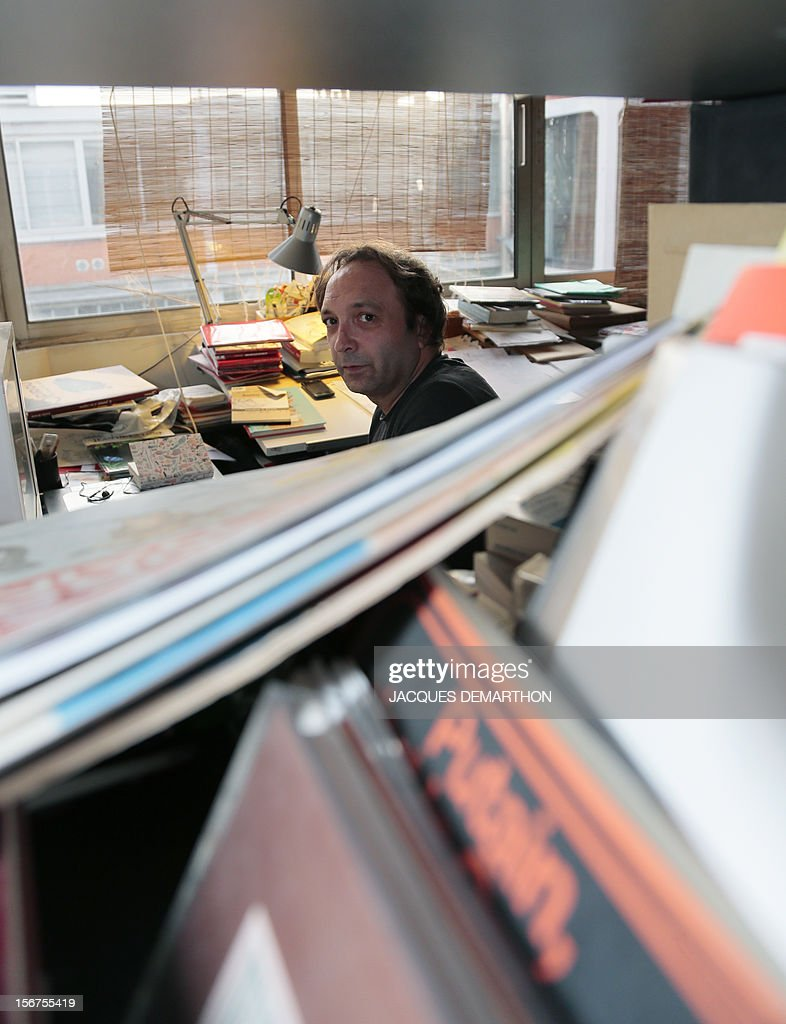 French author and illustrator, Emile Bravo poses at his office on November 20, 2012 in Paris.