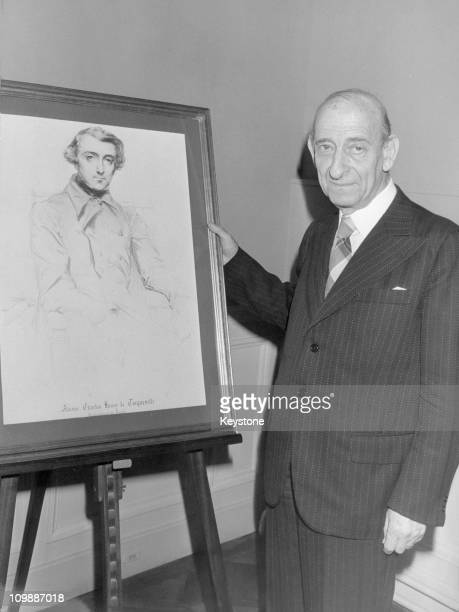 French author Raymond Aron with a portrait of Alexis de Tocqueville 17th December 1979 He has just been awarded the Tocqueville prize