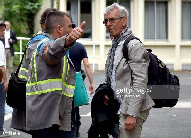 French auto parts manufacturer GMS workers' lawyer JeanLouis Borie and CGT unionist of the GMS company Yann Augras arrive at the trade court in...