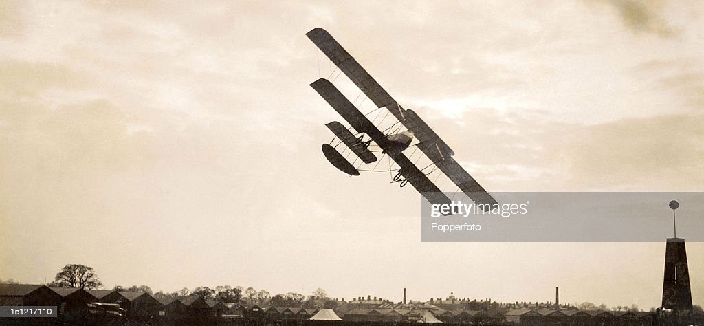 French aviator Pierre Verrier banking in Military Aircraft No. 207, a Maurice Farman S-7 biplane, at Hendon Aerodrome, London, 14th August 1914.