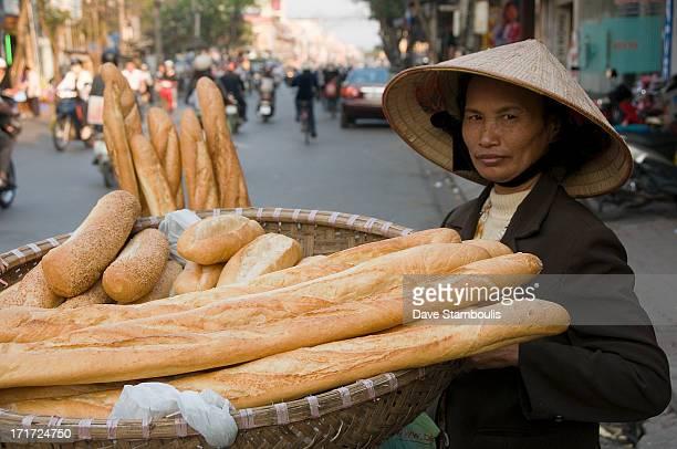 French baguette vendor on the streets of Hanoi Vietnam