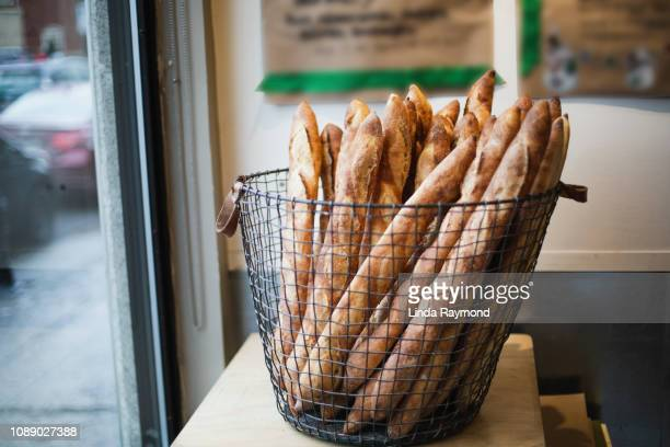 french baguettes in a bakery - french food stock pictures, royalty-free photos & images