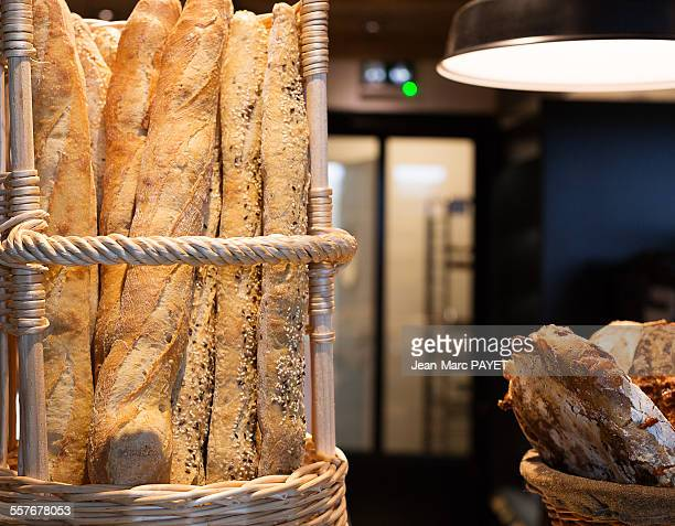 french baguettes in a bakery - jean marc payet stock pictures, royalty-free photos & images