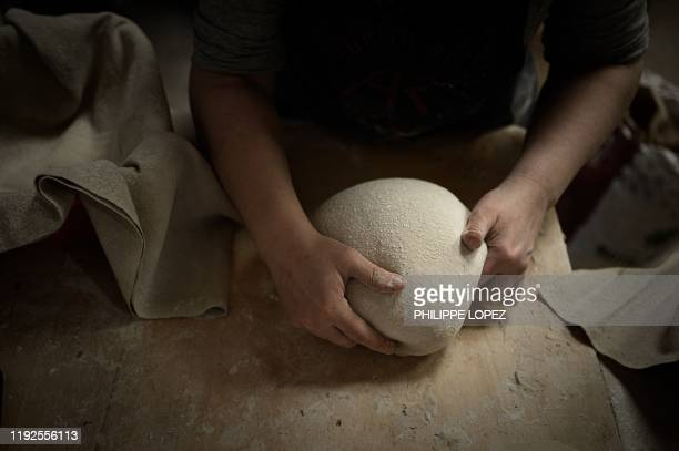 French baker Aurelie Ribay prepares bread dough on January 8 2020 at her bakery in Paris