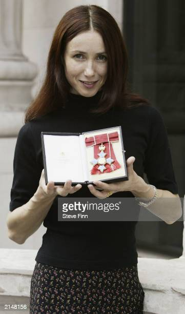 French ballerina Sylvie Guillem displays her honorary CBE which was presented by Culture secretary Tessa Jowell July 9 2003 in London