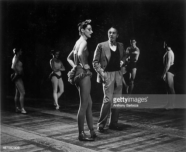 French ballet dancer Tanaquil LeClercq stands with Russianborn American choreographer George Balanchine during a rehearsal 1950s