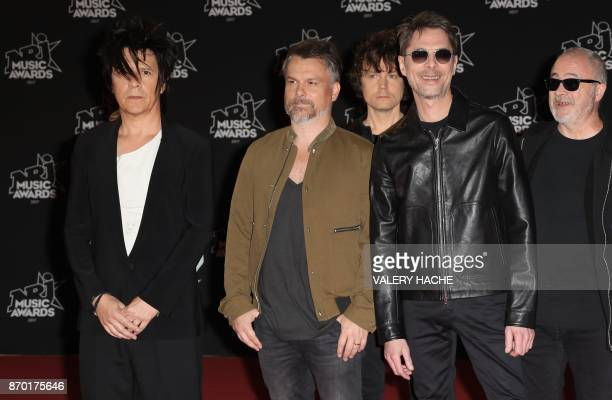 French band Indochine members singer Nicola Sirkis guitarist Oli de Sat and guitarist Boris Jardel pose upon their arrival to attend the 19th NRJ...