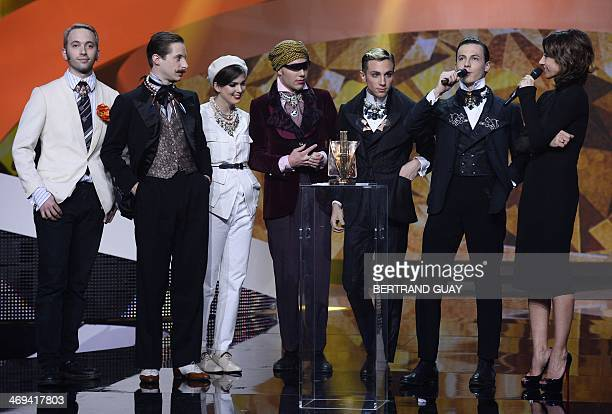 French band La Femme deliver a speech after receiving the best newcomer's album of the year award for their album Psycho Tropical Berlin next to...