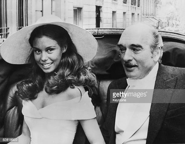 French bandleader producer and record executive Eddie Barclay with his third wife Beatrice Chatelier after their wedding in Paris 7th June 1970
