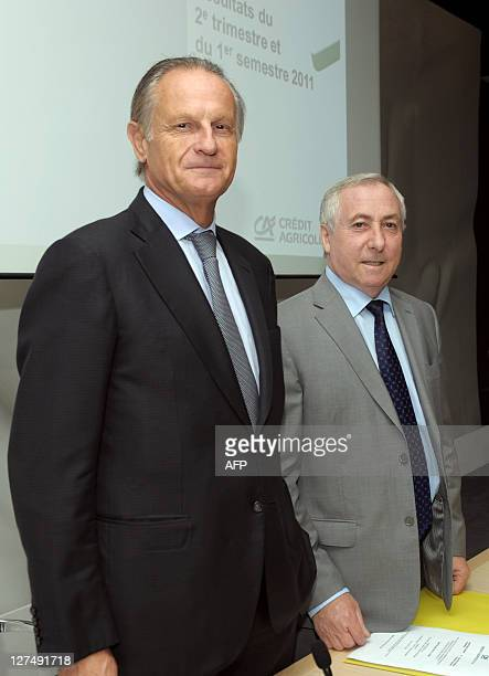 French bank Credit Agricole CEO Jean-Paul Chifflet and Chairman of the board Jean-Marie Sander pose prior to the start of a press conference at the...