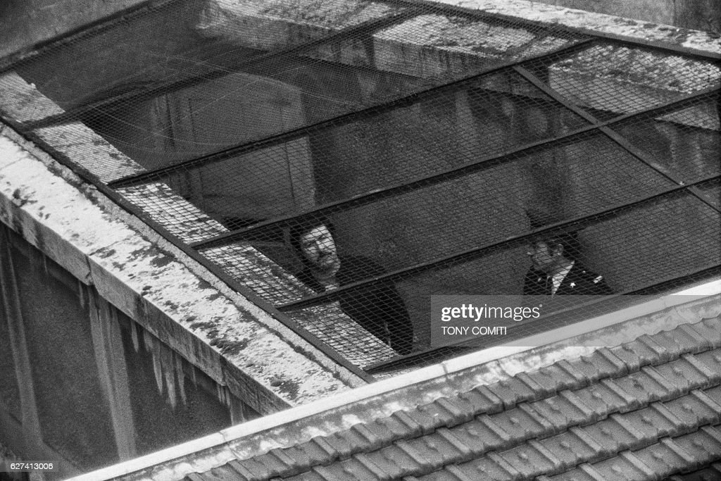 French bank robber and kidnapper Jacques Mesrine, nicknamed 'the man of a thousand faces' and declaired 'public enemy number one', in the high-security quarters of Sante Prison, from which he will manage to escape.