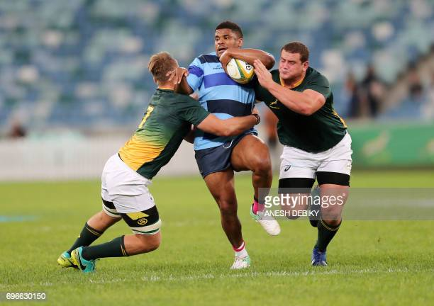 French Barbarians' Jonathan Danty is tackled by South Africa's Ruan Ackerman and Wilco Louw during a rugby union test match between French Barbarians...
