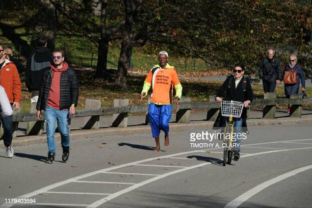 French barefoot runner Sidy Diallo, who will run the November 3 New York City Marathon barefoot, trains in Central Park, New York, on November 1,...