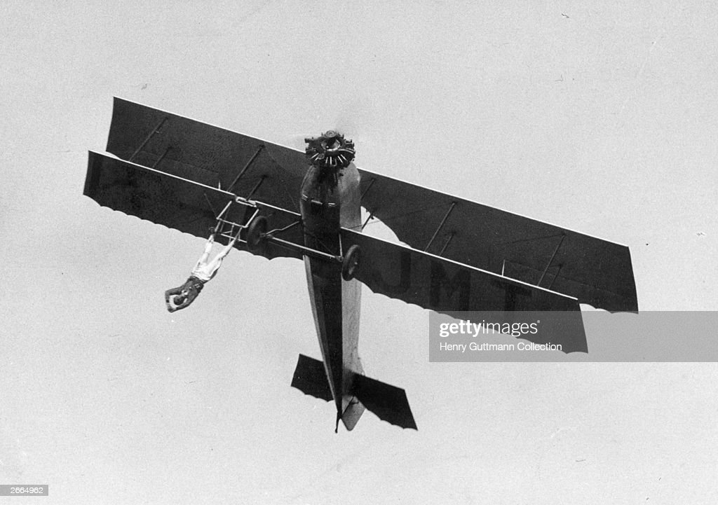 French barnstormer Vassard performing one of his death-defying stunts.
