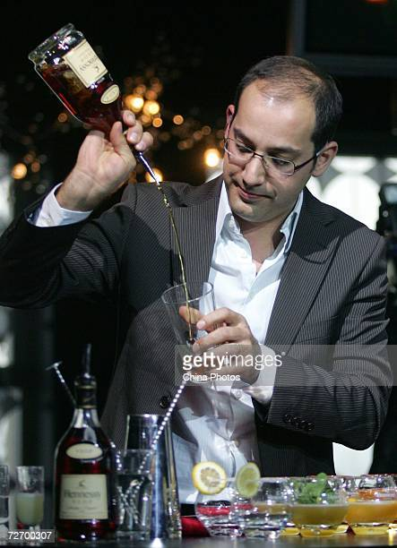 French Bartender Fernando Castellon shows visitors how to make different cocktails during a press conference of the Hennessey Global Artistry Tour on...
