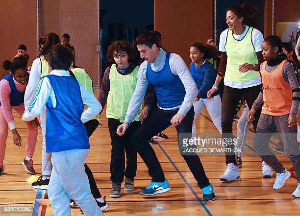 French basketball player and 'Education' ambassador' Emmeline Ndongue and copresidents of the Paris bid for the 2024 Olympics Tony Estanguet play...