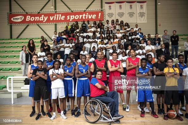 French basketball player and member of the Paris2024 Olympic delegation Tony Parker poses along with delegation member JeanPhilippe Gatien Paris2024...