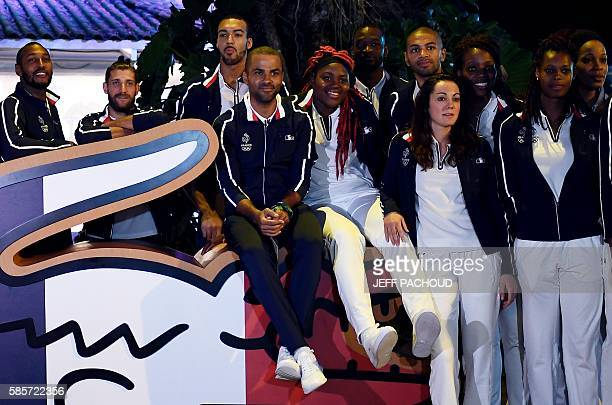 French basketball player Tony Parker poses with members of France's Olympic team ahead of the Rio 2016 Olympic Games on August 3 at the 'Club France'...