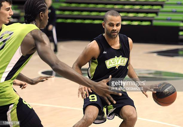 French basketball player Tony Parker practices with teammates Leo Westermann and JeanCharles Livio during his first training session with is new team...