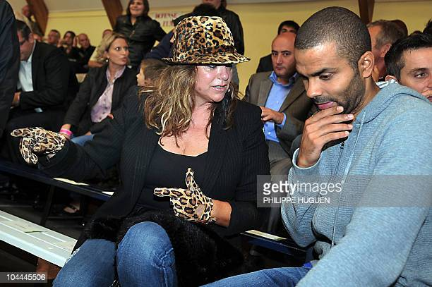 French Basketball player Tony Parker speaks with his mother Pamela Firestone before the basketball match BC Orchies versus GET Vosges in which his...