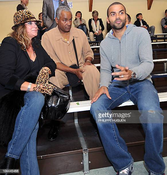 French Basketball player Tony Parker speaks with his parents before the basketball match BC Orchies versus GET Vosges in which his brother Terence...