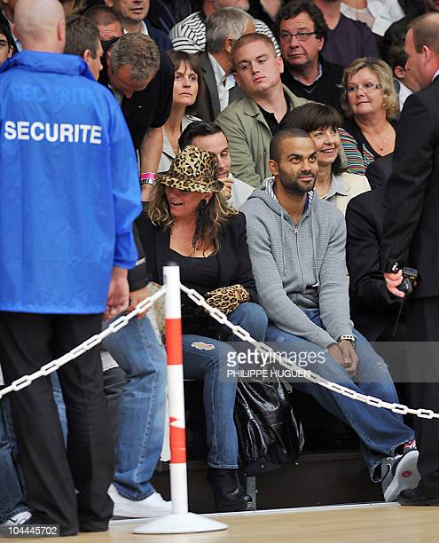 French Basketball player Tony Parker waits next to his mother Pamela Firestone for the beginning of the basketball match BC Orchies versus GET Vosges...