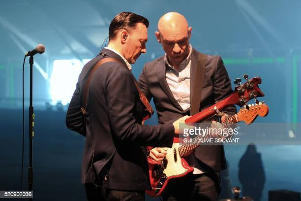 French bass player Robin Feix and French singer Gaetan Roussel of French band Louise Attaque rehearse on stage during the 40th edition of Le...