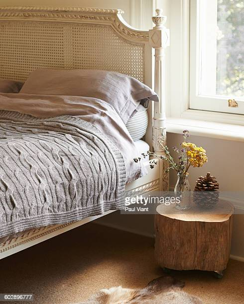 french bed with linen and blankets - animal skin rug stock photos and pictures