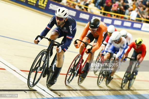 French Benjamin Thomas followed by Dutch Jan Willem van Schip compete during the Omnium Men's Points Race Finals at the European Track Cycling...