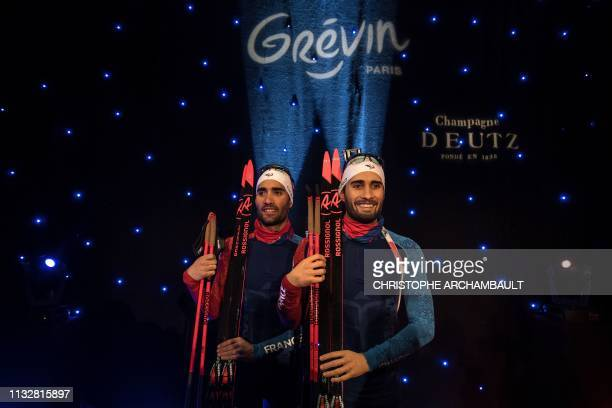 French biathlon athlete Martin Fourcade poses by a wax sculpture of himself during its inauguration ceremony at the Musee Grevin wax museum in Paris...
