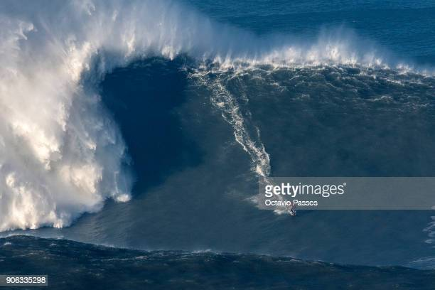 French big wave surfer Benjamin Sanchez drops a wave during a surf session at Praia do Norte on January 18 2018 in Nazare Portugal