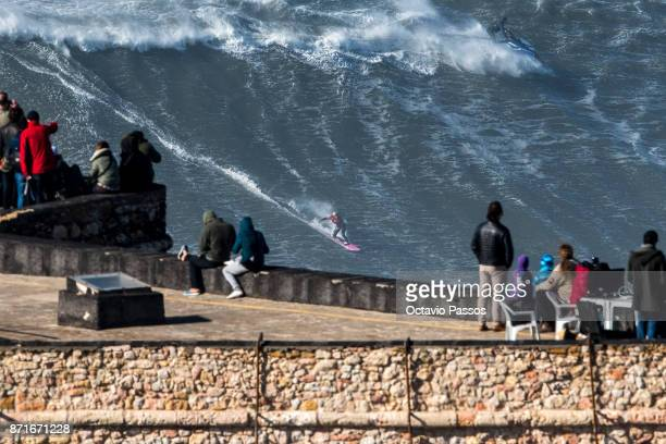French big wave surfer Justine Dupont drops a wave during a surf session at Praia do Norte on November 8 2017 in Nazare Portugal
