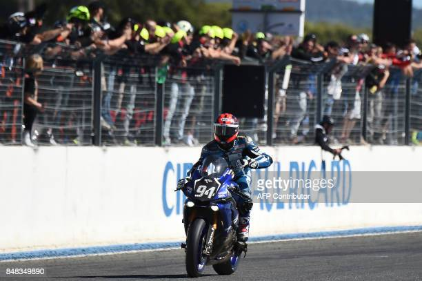 French biker Mike Di Meglio, riding his Yamaha YZF-R1, celebrates after winning the 81th Bol d'Or 24-hour motorbike race, on September 17 at the Paul...