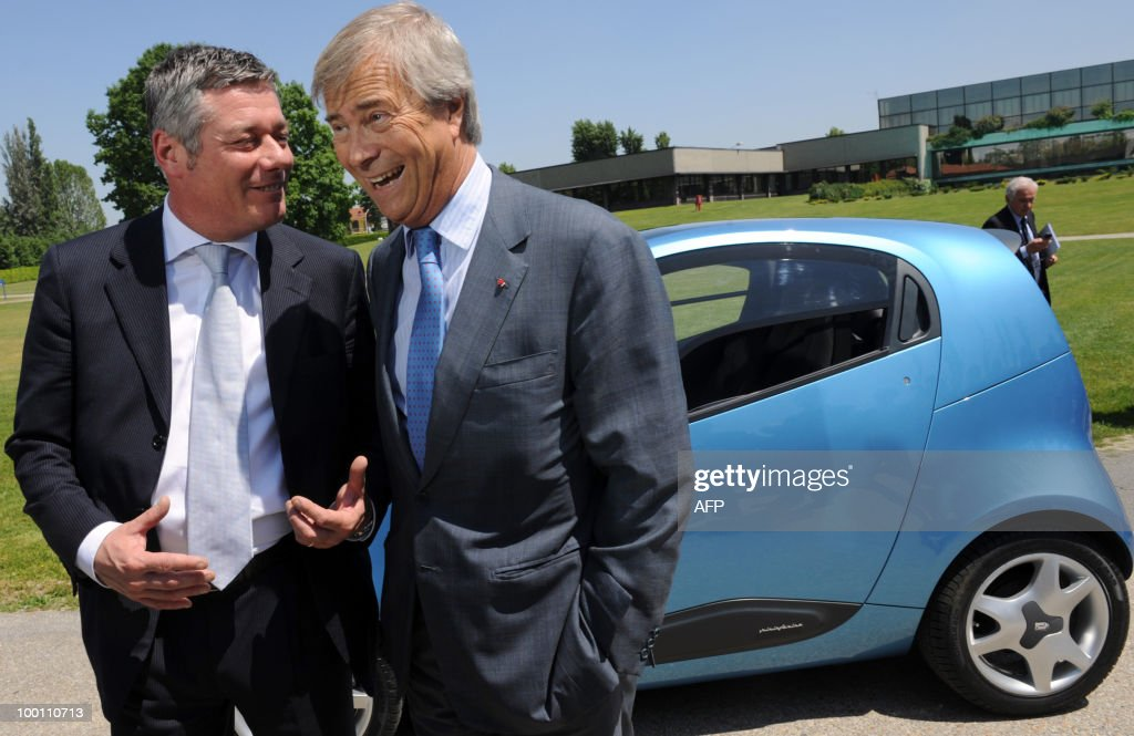 French billionaire Vincent Bollore (R) poses with Italina car maker Pininfarina President Paolo Pininfarina in front of the new electric car 'Nido' as part of the 80th anniversary of Pininfarina group in Cambiano near Turin on May 21, 2010.