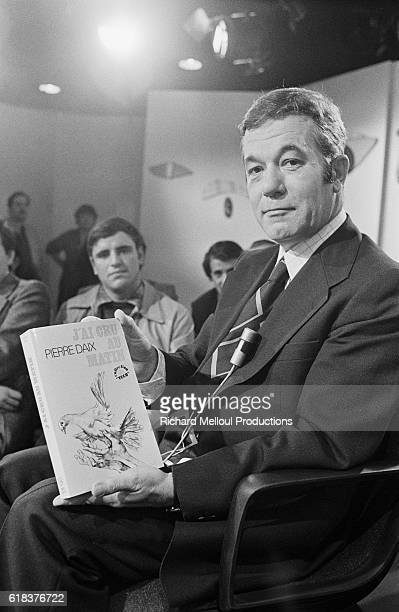 French biographer Pierre Daix appears on the literary talk show Apostrophes He is holding a copy of his book J'ai Cru au Matin