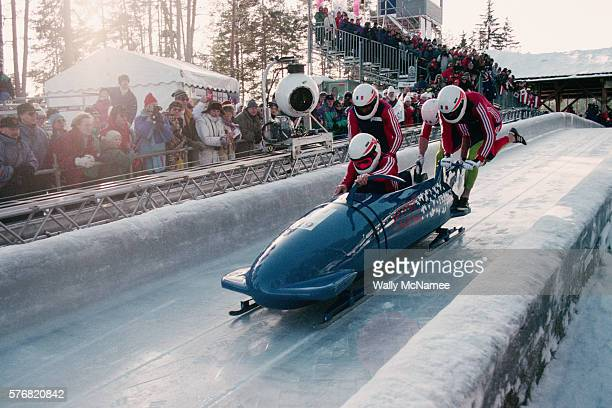 French Bobsledding Team Starting a Run