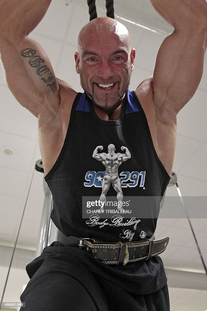 French bodybuilder Alexandre Piel exercises in a gym on
