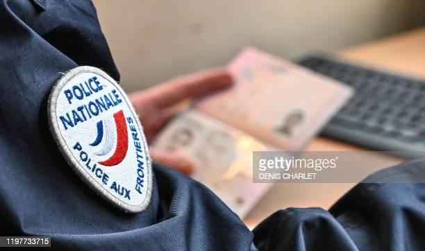 French border police officers checks identification documents at the entrance of the Channel Tunnel in Coquelles, northern France, on Brexit Day,...