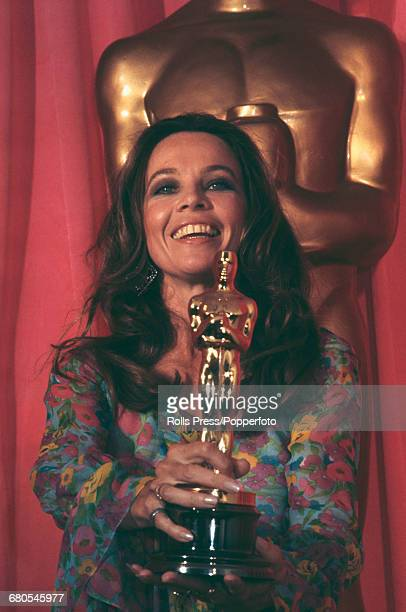 French born American actress Leslie Caron pictured holding an Oscar statuette award as she attends the 43rd Academy Awards at the Dorothy Chandler...
