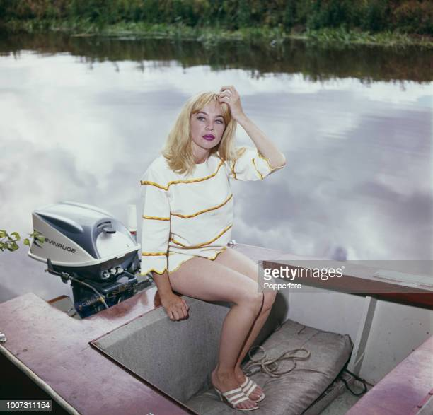 French born American actress Leslie Caron pictured seated in a boat on a river in England in 1961.