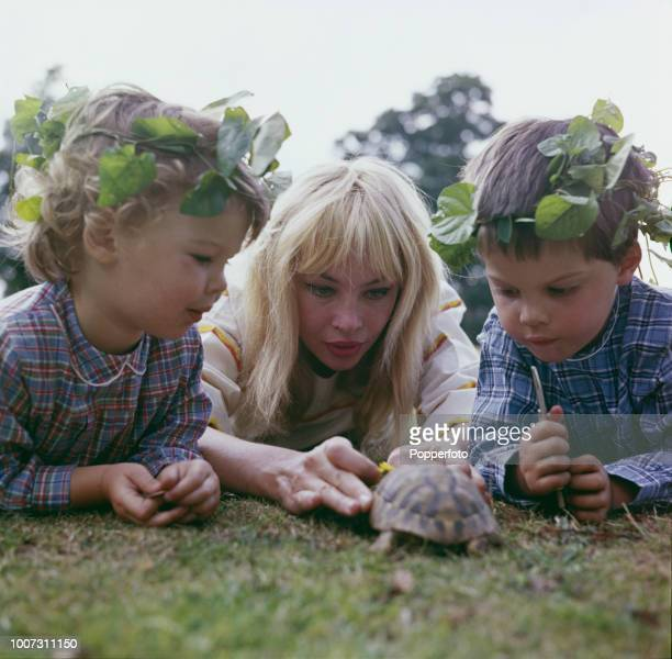 French born American actress Leslie Caron pictured with her two children Jennifer Caron Hall and Christopher Hall as they play with a pet tortoise in...