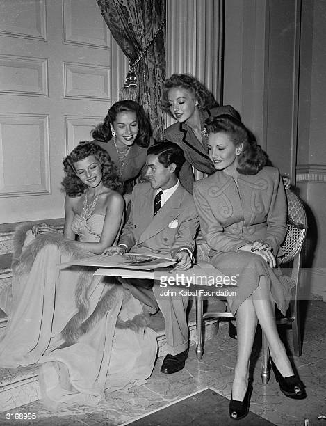 French born Columbia costume designer Jean Louis is surrounded by Hollywood beauties Rita Hayworth Jinx Falkenburg Evelyn Keyes and Janet Blair...