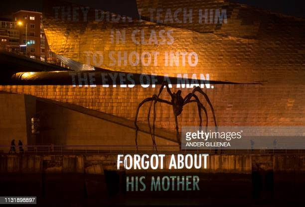 French born US artist Louise Bourgeois's sculpture 'Maman' is pictured while US artist Jenny Holzer's projection mapping creation entitled 'For...