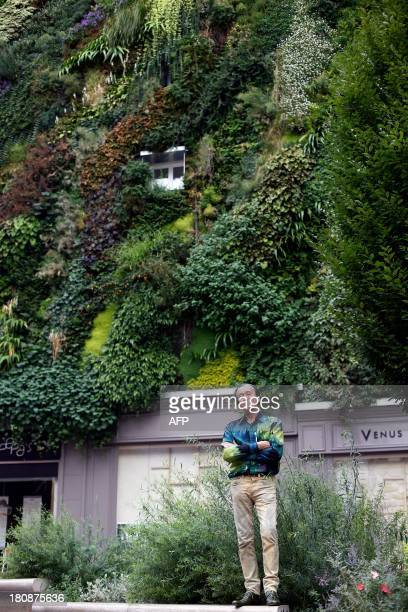 French botanist and innovator of the green wall Patrick Blanc stands in front of his latest project in Aboukir street in Paris on September 10 2013...