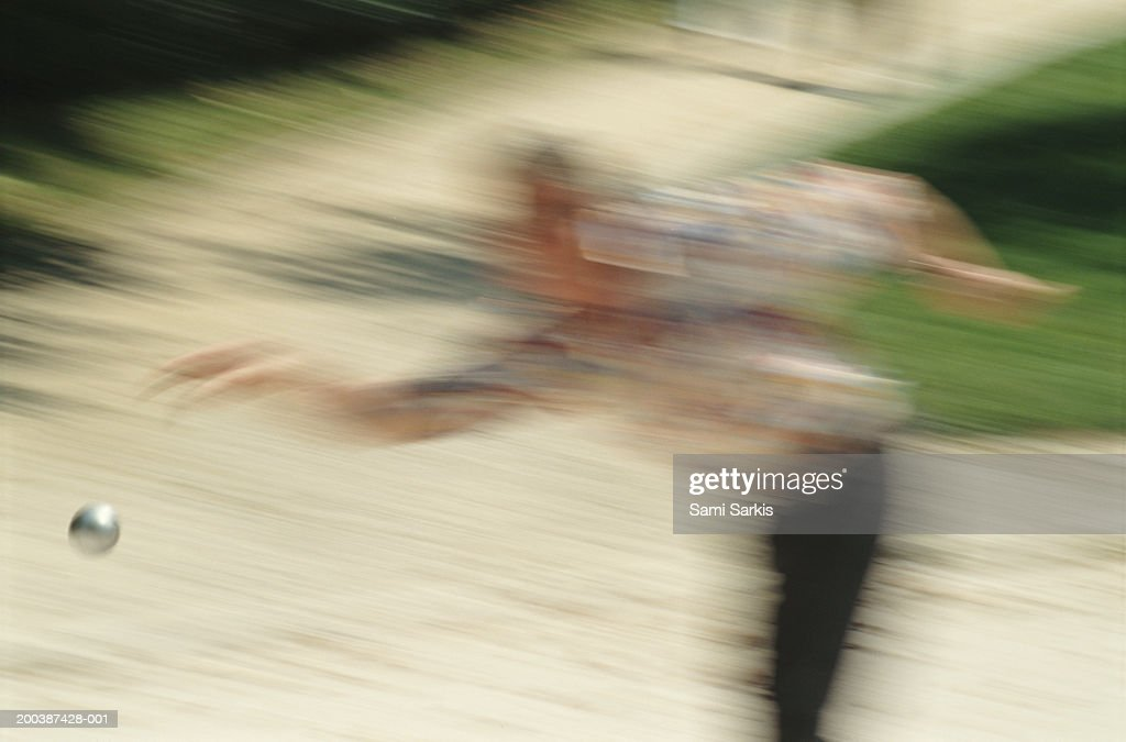 French boules player throwing boule (defocussed) : Stock Photo