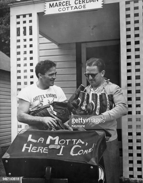 French boxer and World Middleweight champion Marcel Cerdan and his manager Joe Longman leave Marcel Cerdan Cottage in the Hotel Evans Loch Sheldrake...